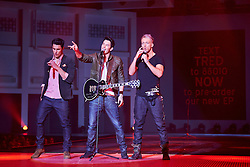 © Licensed to London News Pictures.  07/12/2012. BIRMINGHAM, UK. Boy band Times Red perform during the Fashion Theatre catwalk show at the Clothes Show Live event being held in the NEC, Birmingham. The show opens today and runs until Tuesday. Photo credit :  Cliff Hide/LNP