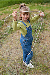 United States, Montana, Deer Lodge, Grant-Kohrs Ranch National Historic Site, girl (age 6) with lasso.  MR
