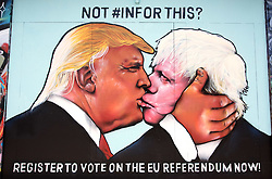 © Licensed to London News Pictures.24/05/2016. Bristol, UK.  Mural with Boris Johnson and Donald Trump kissing, on Stokes Croft in Bristol, in the run up to the EU referendum. Photo credit : Simon Chapman/LNP