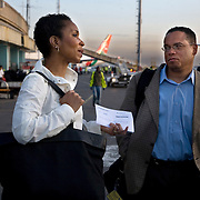 President and CEO of CARE, Helene Gayle, speaks with representative Keith Ellison, at the airport in Nairobi before flying to western Kenya, on a Learning Tours trip to Kenya.