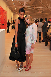 Left to right, TOLULA ADEYEMI and NATHALIE PRESS  at an exhibition of photographic portraits by Bryan Adams entitled 'Hear The World' at The Saatchi Gallery, King's Road, London on 21st July 2009.