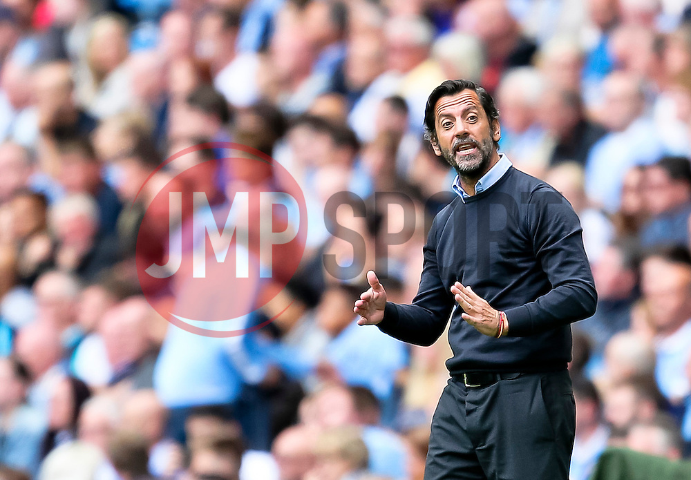 Watford Manager, Quique Flores talks to his players - Mandatory byline: Matt McNulty/JMP - 07966386802 - 29/08/2015 - FOOTBALL - Etihad Stadium -Manchester,England - Manchester City v Watford - Barclays Premier League