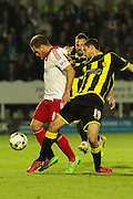 Burton Albion defender Anthony O'Connor and Sheffield United forward Billy Sharp challenge for the ball during the Sky Bet League 1 match between Burton Albion and Sheffield Utd at the Pirelli Stadium, Burton upon Trent, England on 29 September 2015. Photo by Aaron Lupton.