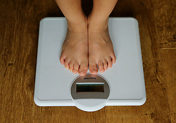 Embargoed to 0001 Thursday November 22 File photo dated 15/07/14 of a child being weighed on scales. Diabetes UK has said the rising tide of obesity has led to thousands of youngsters having Type 2 diabetes.