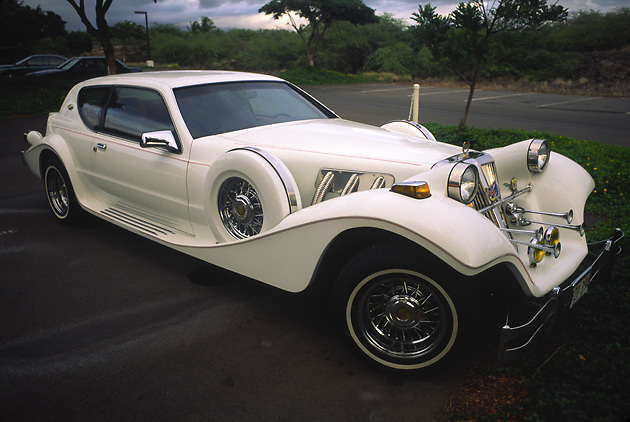 classic Tiffany car; oyster white; exterior horns; transportation