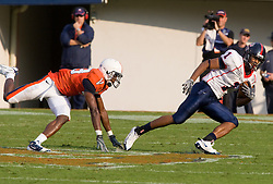 Richmond wide receiver Kevin Grayson (1) beats Virginia cornerback Chase Minnifield (13) after a pass reception.  The Virginia Cavaliers defeated the #3 ranked (NCAA Division 1 Football Championship Subdivision) Richmond Spiders 16-0 in a NCAA football game held at Scott Stadium on the Grounds of the University of Virginia in Charlottesville, VA on September 6, 2008.