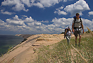 Backpackers climb a trail in the Grand Sable Dunes in Pictured Rocks National Lakeshore near Grand Marais, Michigan.