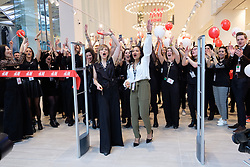 © Licensed to London News Pictures. 20/03/2018. London, UK. H&M staff celebrate the new H&M store opening in Westfield London today launching the first phase opening of its £600m expansion, 6-months ahead of schedule. Photo credit: Ray Tang/LNP