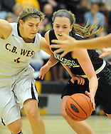 DOYLESTOWN, PA - DECEMBER 16: Central Bucks West's Mackenzie Carroll #4 battles Pennridge's Devan Rimmer #22 during the first quarter of a game at Central Bucks West December 16, 2014 in Doylestown, Pennsylvania. (Photo by William Thomas Cain/Cain Images)
