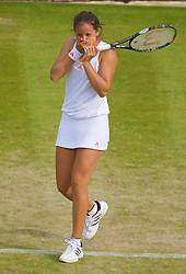 LONDON, ENGLAND - Wednesday, June 24, 2009: Laura Robson (GBR) apologises to her partner Georgie Stoop (GBR) after hitting her with the ball during the Ladies' Doubles 1st Round match on day three of the Wimbledon Lawn Tennis Championships at the All England Lawn Tennis and Croquet Club. (Pic by David Rawcliffe/Propaganda)
