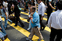 Man on mobile phone at lunch time in Central, Hong Kong