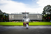 A small group of Vietnamese women have their picture taken in front of the Reunification Palace in Ho Chi Minh City, Vietnam.