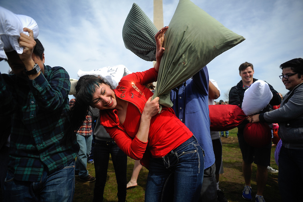 Victoria Stepan tries to defend herself during a massive pillow fight on the National Mall in celebration of International Pillow fight day. April, 05, 2014 in Washington, DC.