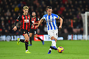 Jonathan Hogg (6) of Huddersfield Town passes the ball during the Premier League match between Bournemouth and Huddersfield Town at the Vitality Stadium, Bournemouth, England on 4 December 2018.