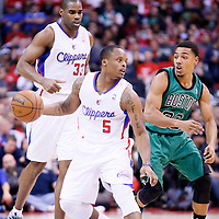 08 January 2014: Los Angeles Clippers Maalik Wayns dribbles past Boston Celtics point guard Phil Pressey (26) during the Los Angeles Clippers 111-105 victory over the Boston Celtics at the Staples Center, Los Angeles, California, USA.