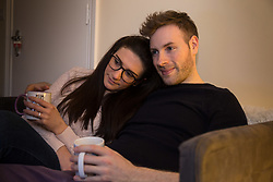 THE SUN - Actor and scriptwriter Joseph Meehan and his fiancé Lilia, a nurse, watch Saturday Night Takeaway in their Ealing flat, as Declan 'Dec' Donnelly  presents the programme without his long term co-presenter Ant McPartlin, who has taken time out to attend rehabilitation for addiction issues following a road accident in Richmond. Ealing, London, March 28 2018.