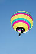 Backlit by the sun, 'Sinbad' glows against the deep blue sky, Crown of Maine Balloon Fair, Presque Isle, Maine.