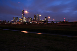 Houston, Texas skyline with bayou in the foreground in the early evening.