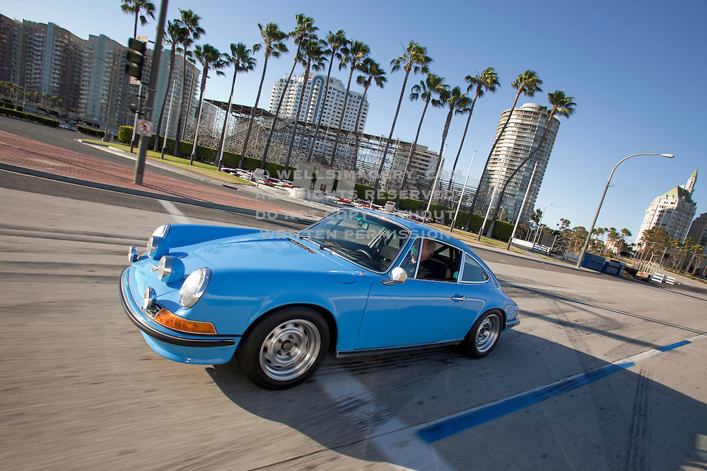 Image of a blue 1971 911T in Long Beach, California, America west coast, model and property released