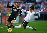 VALENCIA, SPAIN - JANUARY 04:  Lucas Orban of Valencia competes for the ball with Gareth Bale (L) of Real Madrid during the La Liga match between Valencia CF and Real Madrid CF at Estadi de Mestalla on January 4, 2015 in Valencia, Spain.  (Photo by Manuel Queimadelos Alonso/Getty Images)