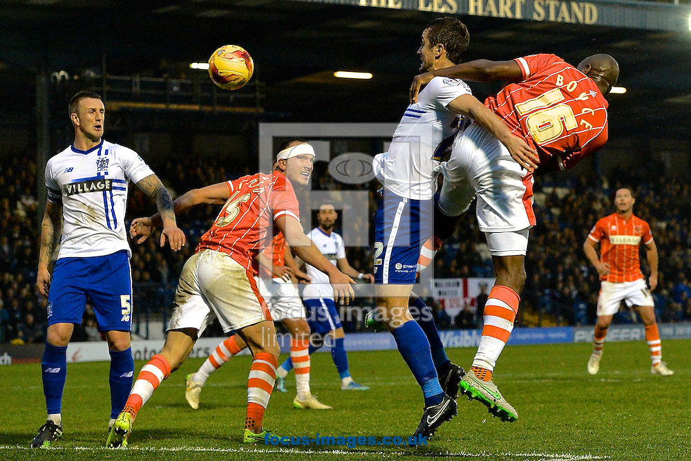 Emmerson Boyce of Blackpool (right) heads at goal during the Sky Bet League 1 match at Gigg Lane, Bury<br /> Picture by Ian Wadkins/Focus Images Ltd +44 7877 568959<br /> 31/10/2015