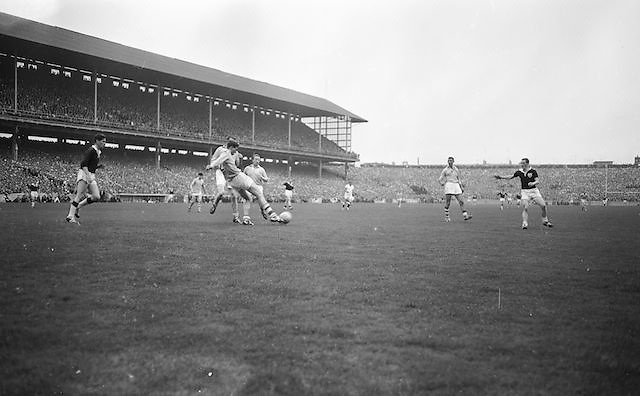 Dublin player slides into kick the ball during All Ireland Senior Gaelic Football Championship Final Dublin V Galway at Croke Park on the 22nd September 1963. Dublin 1-9 Galway 0-10.