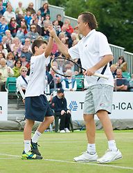 LIVERPOOL, ENGLAND - Sunday, June 21, 2009: Mikael Pernfors (SWE) and a ball boy during Day Five of the Tradition ICAP Liverpool International Tennis Tournament 2009 at Calderstones Park. (Pic by David Rawcliffe/Propaganda)