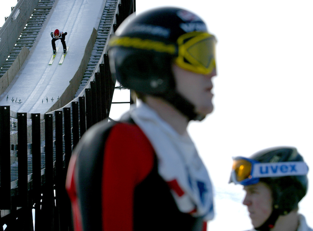 Norge team member A.J. Brown (left) speeds down the K70 hill during the 104th Annual Norge Ski Jump Tournament in Fox River Grove, Ill., Sunday, Jan. 25, 2009. Brown placed third in the J1 division with a combined score of 228.4.