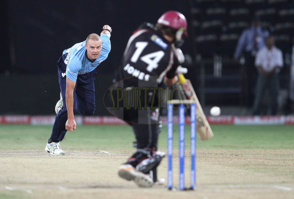 Chris Martin of the Auckland Aces sends down a delivery to Chris Jones of Somerset during the CLT20 - Q4 match between Somerest and Auckland Aces held at the Rajiv Gandhi International Stadium, Hyderabad on the 20th September 2011..Photo by Shaun Roy/BCCI/SPORTZPICS
