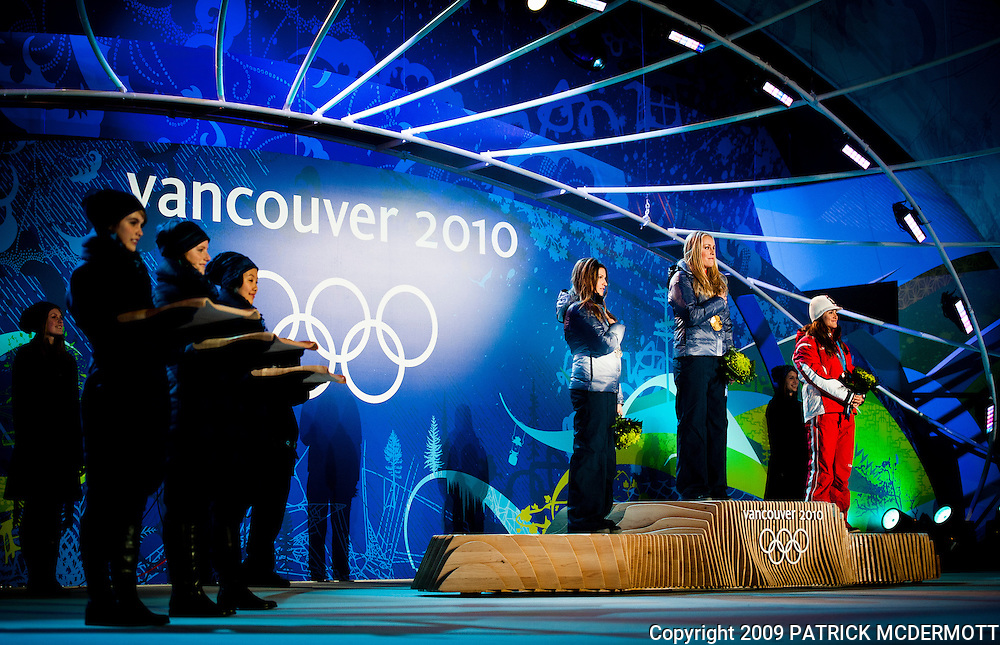 Lindsey Vonn, USA, (C) celebrates her gold medal in the Women's Downhill with Julia Mancuso, USA, (L) and Elisabeth Goergl, AUT, (R) at the 2010 Vancouver Winter Olympics in Whistler, British Columbia, Wednesday, Feb. 17, 2010.