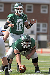 28 September 2013:  Rob Gallik under center Niall Mulcahy during an NCAA division 3 football game between the Hope College Flying Dutchmen and the Illinois Wesleyan Titans in Tucci Stadium on Wilder Field, Bloomington IL