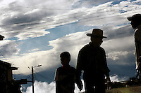 A father and son walk hand in hand down a street in Leiva, a small remote village in the southern Colombian state of Nariño, on Monday, June 25, 2007. (Photo/Scott Dalton)