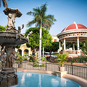 A fountain and pergola in the center of Parque Central. Parque Central is the main square and the historic heart of Granada, Nicaragua.