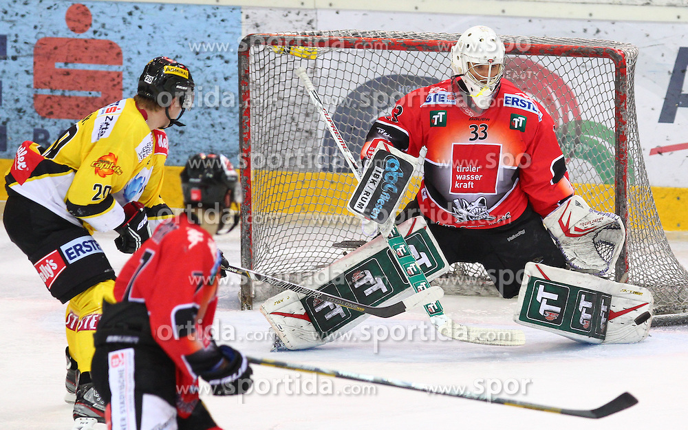 04.01.2013, Albert Schultz Eishalle, Wien, AUT, EBEL, UPC Vienna Capitals vs HC TWK Innsbruck, 38. Runde, im Bild Marcus Olsson, (UPC Vienna Capitals, #20), David Lindner, (HC TWK Innsbruck, #7) und Patrick Machreich, (HC TWK Innsbruck, #33)  // during the Erste Bank Icehockey League 38th Round match betweeen UPC Vienna Capitals and HC TWK Innsbruck at the Albert Schultz Ice Arena, Vienna, Austria on 2013/01/04. EXPA Pictures © 2013, PhotoCredit: EXPA/ Thomas Haumer