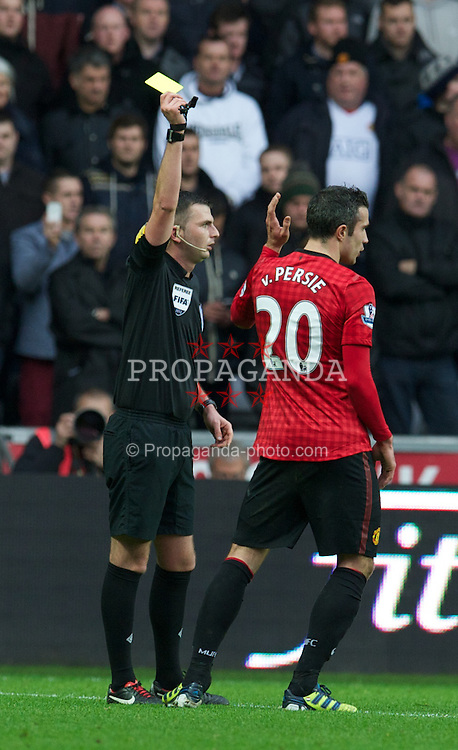 SWANSEA, WALES - Sunday, December 23, 2012: Manchester United's Robin van Persie is shown a yellow card by referee Michael Oliver during the Premiership match against Swansea City at the Liberty Stadium. (Pic by David Rawcliffe/Propaganda)