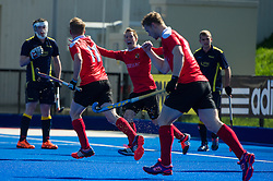 Holcombe's James Stedman and Barry Middleton celebrate  scoring their first goal. Holcombe v Team Bath Buccaneers - Now: Pensions Finals Weekend, Lee Valley Hockey & Tennis Centre, London, UK on 12 April 2015. Photo: Simon Parker