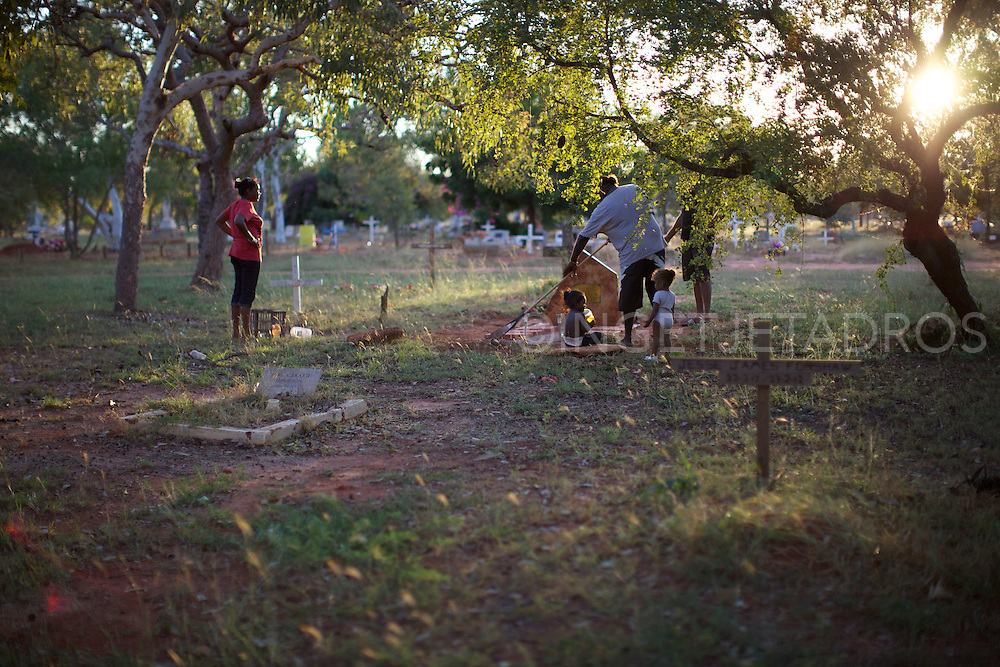 Lorna and Family cleaning the grave of her mother