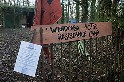 Wendover, UK. 10 January, 2020. A sign and notice outside the newly-established Wendover Active Resistance Camp. Stop HS2 activists from around the UK established the camp in woodland outside Wendover on the proposed route for HS2 through the Chilterns AONB in response to requests for assistance from members of the local community opposed to the high speed rail link. The impact on the immediate area is expected to be even worse than initially expected, with not only two 500m viaducts and a 1km embankment to be constructed but also a Bentonite factory and 240-bed accommodation block.