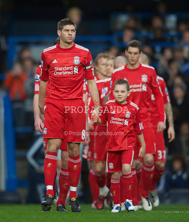 LONDON, ENGLAND - Sunday, February 6, 2011: Liverpool's captain Steven Gerrard leads his team out prior to the Premiership match against Chelsea at Stamford Bridge. (Photo by Chris Brunskill/Propaganda)