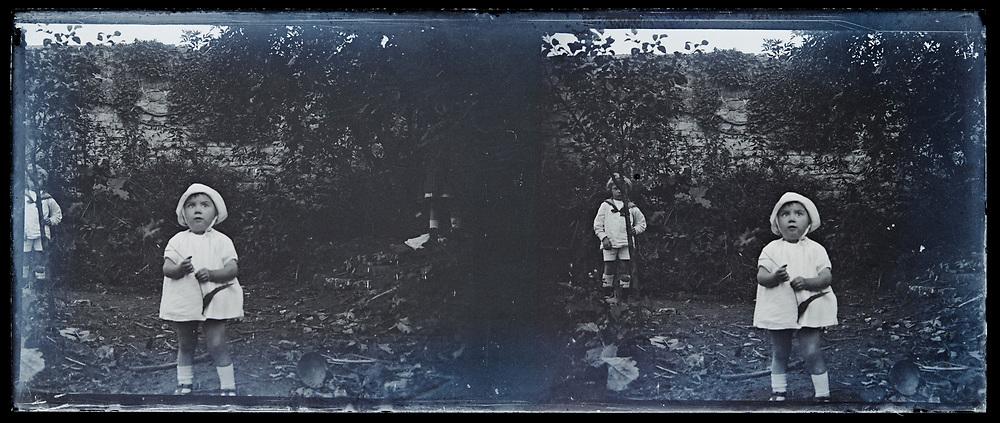 toddler posing in garden stereo image 1920s France