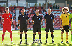 WREXHAM, WALES - Friday, September 6, 2019: Referee Danilo Grujić (C) alongside assistant referees Nemanja Petrovic and Pavie Piper and Wales' captain Regan Poole (L) and captain Wout Faes (R) ahead of the UEFA Under-21 Championship Italy 2019 Qualifying Group 9 match between Wales and Belgium at the Racecourse Ground. (Pic by Laura Malkin/Propaganda)