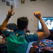 PALM SPRINGS, FLORIDA, JANUARY 14, 2018<br /> Mamudul Hasson, 21, left, and his uncle Yunus Muhammad, watch a football game on the TV in Yunus house. Hassan is a Rohingya Muslim refugee who just arrived to the United States three weeks ago.<br /> (Photo by Angel Valentin/Freelance)