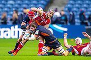 Adrian Motoc (#5) of SU Agen Rugby is tackled by Grant Gilchrist (#5) and Ben Toolis (#4) of Edinburgh Rugby during the European Rugby Challenge Cup match between Edinburgh Rugby and SU Agen at BT Murrayfield, Edinburgh, Scotland on 18 January 2020.