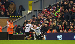 LIVERPOOL, ENGLAND - Sunday, January 17, 2016: Manchester United's captain Wayne Rooney celebrates scoring the winning goal against Liverpool with team-mate Morgan Schneiderlin during the Premier League match at Anfield. (Pic by David Rawcliffe/Propaganda)