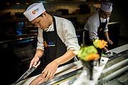 DUBAI, UAE - DECEMBER 18, 2015: A chef is preparing seafood at Nobu Dubai restaurant, Atlantis, The Palm Jumeirah.