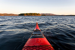 A kayak on at dawn on Lake Winnipesauke in Meredith, New Hampshire.