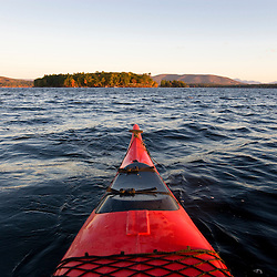 A kayak on at dawn on Lake Winnipesauke in Meredith, New Hampshire.