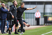 Forest Green Rovers assistant manager, Scott Lindsey and Forest Green Rovers manager, Mark Cooper give instructions during the EFL Sky Bet League 2 match between Forest Green Rovers and Port Vale at the New Lawn, Forest Green, United Kingdom on 8 September 2018.
