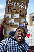 Baltimore, Maryland - April 21, 2015: during a vigil-turned-protest march for the death of Freddie Gray who was injured while detained by police, and died from his injuries Sunday. His spinal cord was 80% severed.<br /> <br /> CREDIT: Matt Roth for The New York Times<br /> Assignment ID: 30173645A