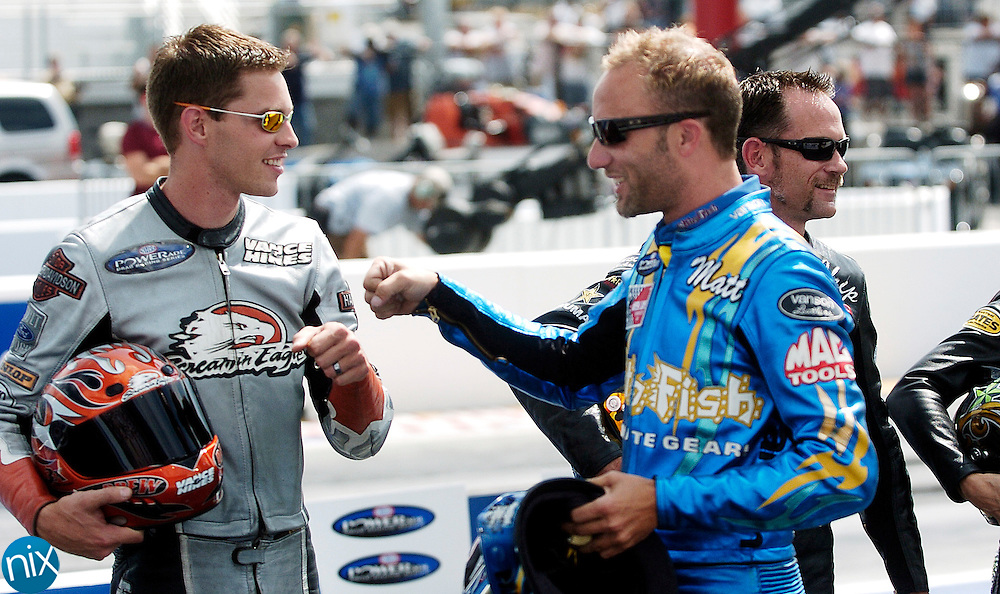 NHRA Pro Stock Motorcycle points leader Matt Smith fist pumps Andrew Hines as they are introduced at the Carolinas Nationals at zMAX Dragway @ Concord Friday, September 12, 2008. (photo by James Nix)